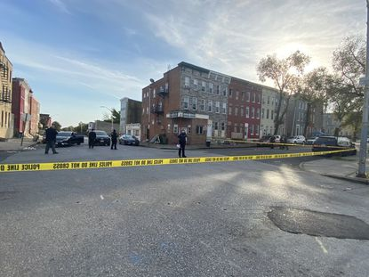 Police investigate a crime scene in the 1400 block of Mosher St. in the Sandtown-Winchester neighborhood in West Baltimore.