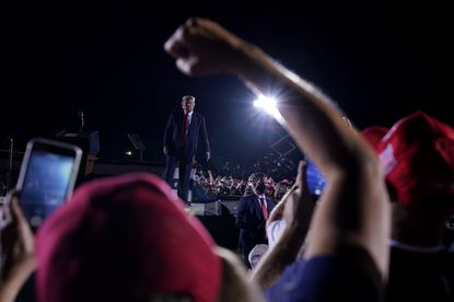 In this Oct. 16, file photo supporters cheer as President Donald Trump leaves after speaking at a campaign rally at Middle Georgia Regional Airport in Macon, Georgia.