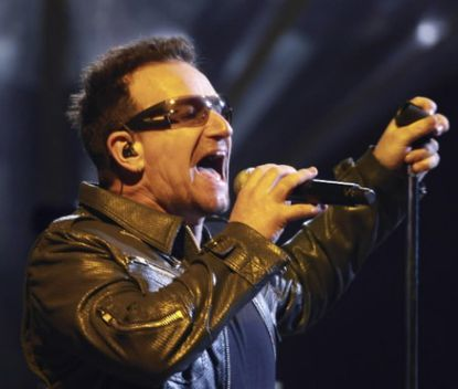 Irish singer Bono of the Rock band U2 perfom on their 360Tour at the Azteca Stadium in Mexico City, on May 11, 2011.