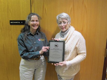 Donna Davis, Project Forester, Maryland Forest Service (left), presented Carroll County Forestry Board Chairman Connie Hoge with the Maryland Association of Forest Conservancy District Boards Lifetime Achievement Award during a monthly meeting of the Carroll County Forestry Board on March 17, at the Westminster Senior Community Center.