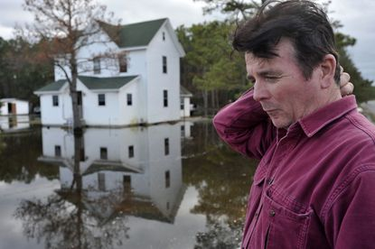 Gary Catlin of Fairmount, in Somerset County, talks about the damage his property sustained from tidewater that was pushed into his community by Superstorm Sandy.