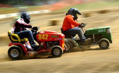 Ken Jones, left, driving a John Deere, and Tad Butterfield, driving a Wizard mower, compete in the Mod XR class during Lawn Mower Racing at the Carroll County 4H & FFA Fair in Westminster Sunday, July 29, 2012.