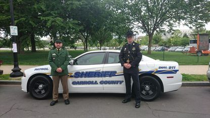Carroll County Sheriff's Deputy Michael Hugel, right, and Florian Behrens, polizeiobermeister or a senior police officer in Bavaria, Germany, first met through an online policing forum.