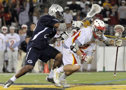 Calvert Hall's Stephen Kelly tries to elude Gilman's Micah Kiser in the first half of last year's Maryland Interscholastic Athletic Association A Conference championship. Tuesday's rematch could also be a preview of this year's MIAA final.