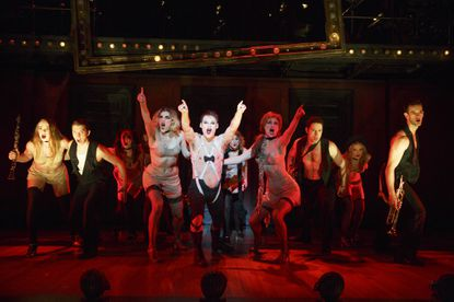 """Randy Harrison, center, as the Emcee and the national touring cast of """"Cabaret."""""""
