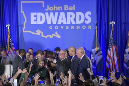 Louisiana Gov. John Bel Edwards arrives to address supporters at his election night watch party in Baton Rouge, La. Voters reelected Mr. Edwards to a second term, as he defeated Republican businessman Eddie Rispone.