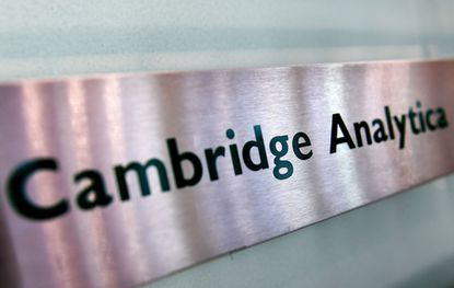 Cambridge Analytica's sign is seen at their offices in London on March 21, 2018.