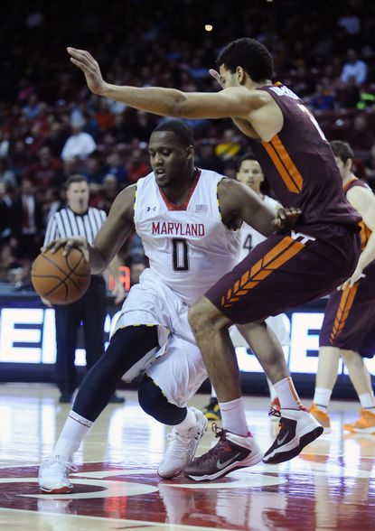 Maryland's Charles Mitchell drives against Virginia Tech's Joey Van Zegeren at Comcast Center.
