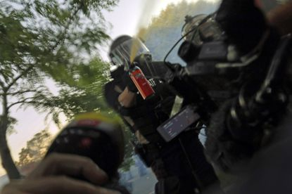 Minnesota State Patrol officers spray journalists with pepper spray and fire rubber bullets while they are working, despite their exemption from the curfew on Saturday, May 30, 2020.