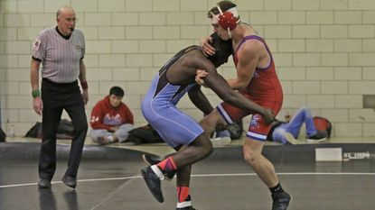Western Tech's Ike Kalu, left, shown grappling with Lansdowne's Jacob Beck last season, has a 14-0 record this year. Kalu, a junior, won a regional title as a sophomore and placed fourth at the state tournament.