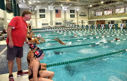 North Baltimore Aquatic Club swimming coach Tom Himes works with young swimmers during a morning practice session at the fitness and aquatics center at Loyola University Maryland. The NBAC has entered a different phase in its history, training away from its traditional home at the Meadowbrook Swim Club and focusing on younger swimmers instead of Olympians.