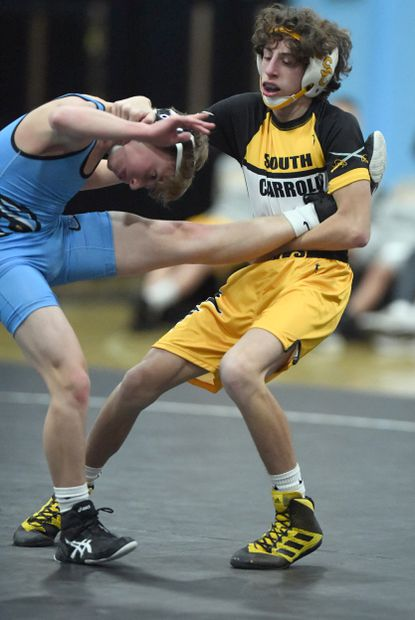 South Carroll freshman Michael Pizzuto, seen on the right controlling the leg of Westminster's Ty Streib on Dec. 18, is 21-0 on the season and part of a dominant lightweight crew for the Cavs wrestling team.