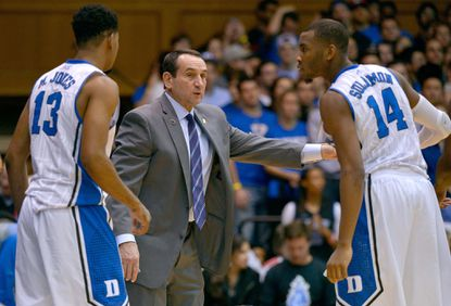 Duke coach Mike Krzyzewski talks to Rasheed Sulaimon during a November 2014 game.