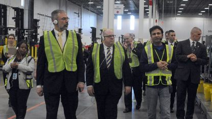 Piyush Bajpai, right, general manager of Amazon's distribution center in Cecil County, gave U.S. Rep. Andy Harris, left, and Maryland Gov. Larry Hogan a tour of the facility last year.