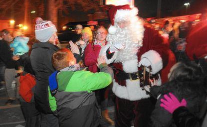 Santa is greeted by children and their families as he arrives to Arbutus Town Hall on Saturday, Nov. 29, 2014.
