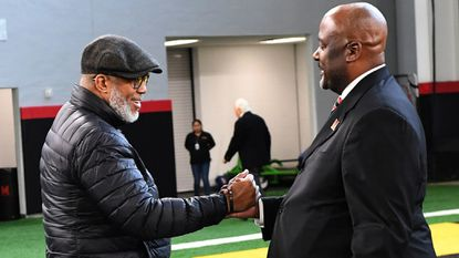 Marty McNair, the father of Maryland lineman Jordan McNair, left, welcomes Michael Locksley before Locksley's introduction as football coach in December.