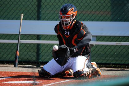 Caleb Joseph catches during drills at the Orioles' spring training complex in Sarasota, Fla.