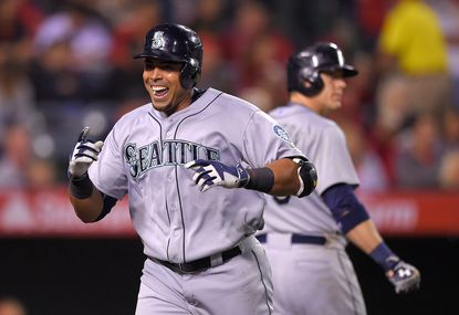 Seattle Mariners' Nelson Cruz, left, celebrates after hitting a solo home run against the Los Angeles Angels as Logan Morrison walks up to bat during the seventh inning, Monday, May 4, 2015, in Anaheim, Calif.