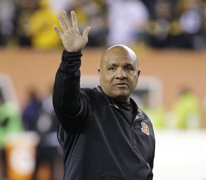 Cincinnati Bengals offensive coordinator waves Hue Jackson before an NFL wild-card playoff game between the Cincinnati Bengals and the Pittsburgh Steelers in Cincinnati onJan. 9, 2016. Jackson was named the Cleveland Browns head coach on Jan. 13, 2016.