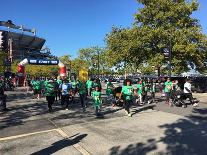 Walkers set off for the ninth annual Donate Life Family Fun Run near Camden Yards. The Living Legacy Foundation hosts the event to celebrate and raise awareness for organ donation.