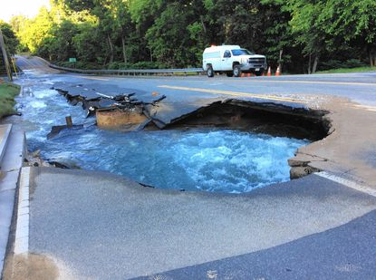 The damage caused to York Road when a water main broke early Monday morning.