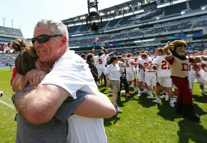 Denvercoach Bill Tierney gets a hug after their 10-5 win over Maryland in the NCAA Division I men's lacrosse championship, Monday, May 25, 2015, Philadelphia.