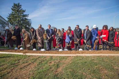 Officials break ground in a ceremony marking the start of Woodlawn High School's $39 million renovation on Nov. 27.