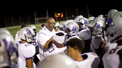 Long Reach head coach Jamie Willis talks to his players before the start of the football game against Atholton on Nov. 3. The Lightning beat Chesapeake to advance to the 3A East regional championship game on Nov. 10.