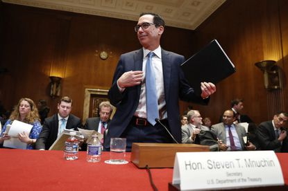 Treasury Secretary Steve Mnuchin gets up after testifying about the budget during a Financial Services and General Government subcommittee hearingon May 15, 2019.