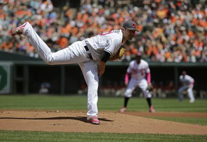 Baltimore Orioles starting pitcher Chris Tillman follows through on a pitch to the Oakland Athletics in the first inning of a baseball game in Baltimore, Sunday, May 8, 2016.