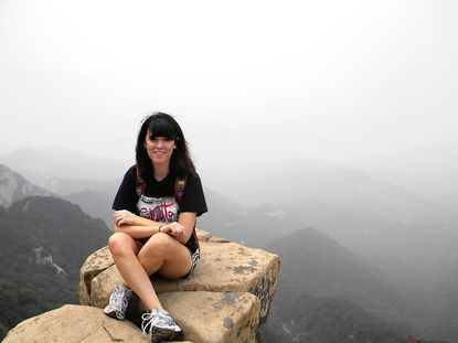 Caitlin Caitlin Hennegan, a 2010 graduate of the John Carroll School, visits at Mount Tai during her study abroad program in China.