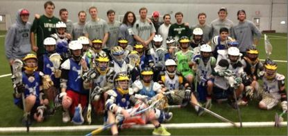 Loyola players with youth players at the clinic in Newtown, Conn. About 100 kids attended the event, which was organized in less than a week.