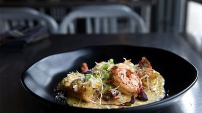 Spicy, cheesy, herby, creamy, winey, garlicky shrimp at The Food Market. The restaurant is one of five in Maryland to be named to OpenTable's Top 100 Brunch Restaurants in America.
