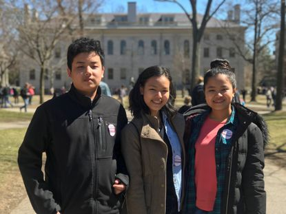 Zung Lung Myitung, center, and her siblings Zung Ying, left, and Zawn Nyaui pose for a photo. Zung Lung Myitung, a refugee from Myanmar along with her siblings and parents, graduated from Hammond High School earlier this month.