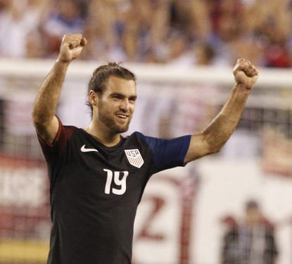 Graham Zusi celebrates after a 1-0 victory over Paraguay on June 11.