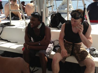Maryland's Charles Mitchell, left, and Spencer Barks go snorkeling Saturday in the U.S. Virgin Islands.