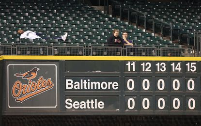 Fans take in the action from the left field bleachers during Tuesday night's 18-inning marathon between the Orioles and Mariners at Safeco Field in Seattle.