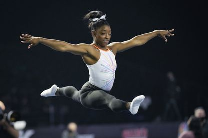 Simone Biles warms up before the U.S. Classic gymnastics competition in Indianapolis, Saturday, May 22, 2021. There, she became the first woman to complete a Yurchenko double pike in competition. (AP Photo/AJ Mast)