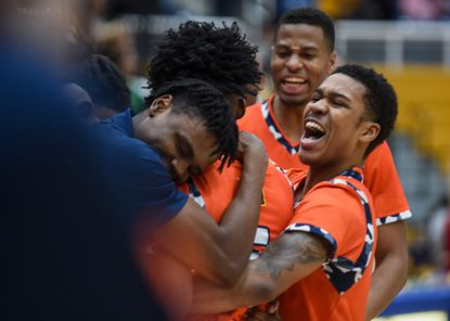 Morgan State players celebrate their comeback win over Coppin State on Saturday, January 25.