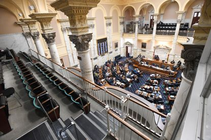 Only state troopers occupied the upper galleries as the Maryland House of Delegates worked March 15, 2020, in the final days of a pandemic-shortened General Assembly session in Annapolis.