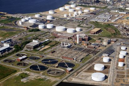 Baltimore's Patapsco wastewater treatment plant, seen from above, is one of nine major facilities in Maryland operating without any numeric limits on nitrogen discharges, report says.