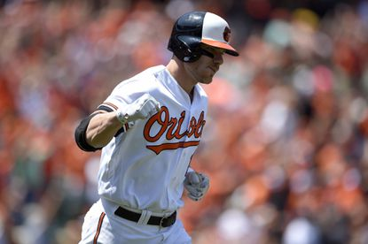 Orioles' Chris Davis reacts as he starts to round the bases after he hit a grand slam during the first inning of a baseball game against the Tampa Bay Rays, Sunday, June 26, 2016, in Baltimore.