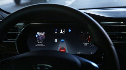 The dashboard of the software-updated Tesla Model S P90D shows the icons enabling Tesla's autopilot, featuring limited hands-free steering.