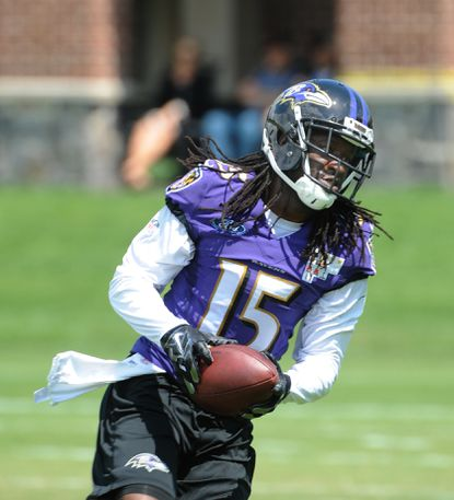 LaQuan Williams #15 catches the ball during the Ravens Training Camp.