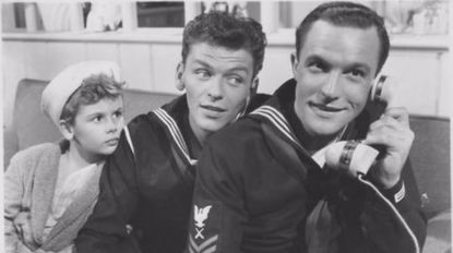 Gene Kelly, right, and Frank Sinatra, center, starred in three films together. But which featured several scenes filmed at the Naval Academy?