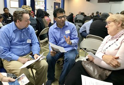 Abdul Rahman, center, a member of the Masjid Al Falaah mosque in Abingdon, participates in group discussions Sunday during Harford County's annual interfaith celebration of the legacy of Martin Luther King Jr. The gathering was held at the mosque this year.