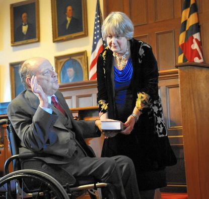 Harford County State's Attorney Joe Cassilly takes his oath of office Monday for his ninth consecutive four-year term as his wife, Diana, holds the Bible during the ceremony.