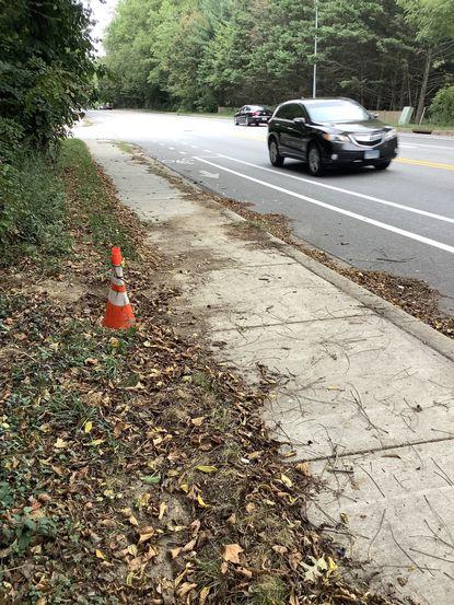 Debris and glass are seen Sept. 14 on the Centennial Lane sidewalk and bike lane. (Courtesy photo/Jo McLaughlin)