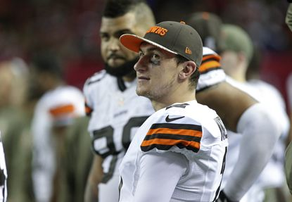 Cleveland Browns quarterback Johnny Manziel is shown on the sideline in the third quarter of their game against the Atlanta Falcons at the Georgia Dome.