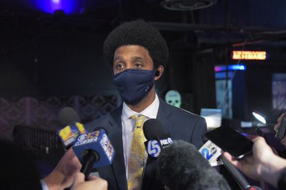 Sporting a retro Afro hair style, Baltimore's democratic mayoral candidate Brandon Scott speaks to the media during his post-election party at Soundstage Tue., Nov. 3, 2020. (Karl Merton Ferron/Baltimore Sun Staff)